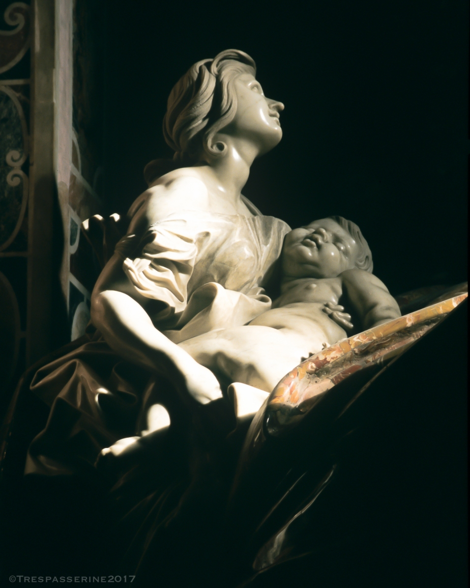 Bernini's Woman with Child on the Tomb of Pope Alexander XII, St Peter's Basilica, Rome.