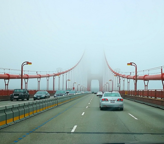 A fog-shrouded Golden Gate Bridge on entry to the Bay